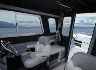 Stay out of the elements with a comfortable roomy cabin with seating for 6 and lockable bulkhead door