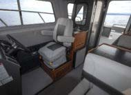 Marine grade weather tight door, suspension helm seat, feature packed galley and stand up enclosed head