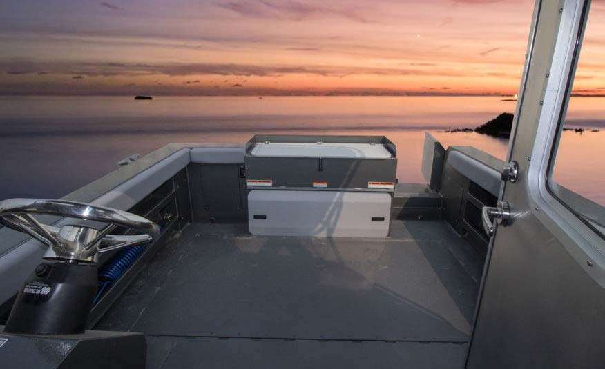 Available rear helm station, 120 USG in floor fuel tank, maximum 250 HP, transom fish locker with cutting board, side storage trays