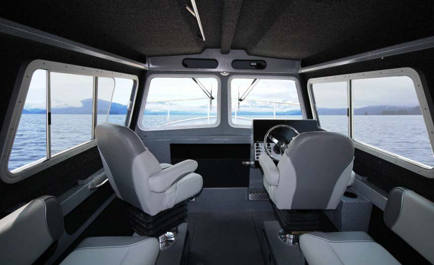 Spacious cabin interior with oversized console for flush mount electronics