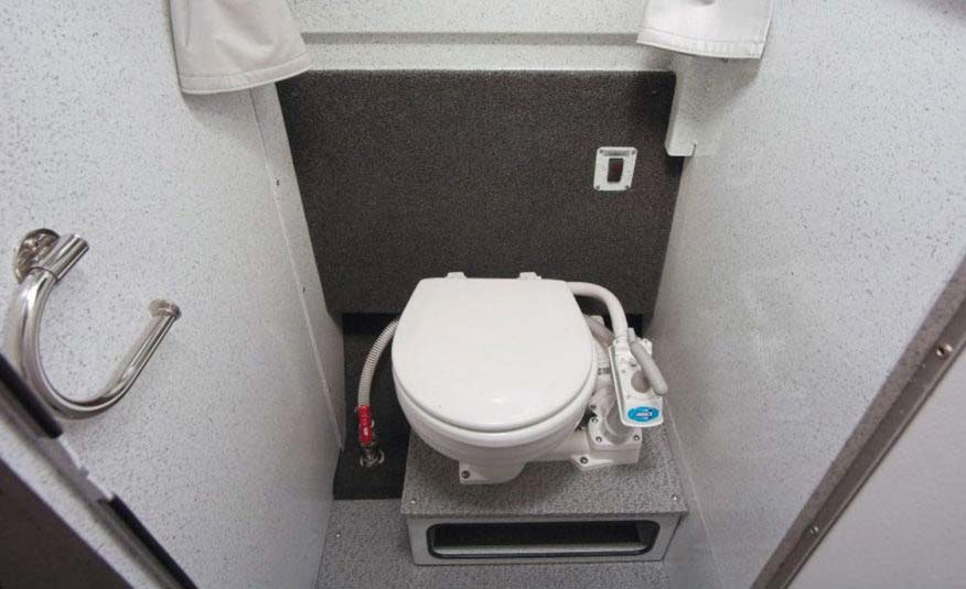 Optional enclosed stand-up head or choose flush toilet inside bench seat option