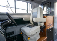 Marine grade weather tight door, suspension helm seat, feature packed galley and stand up enclosed head.