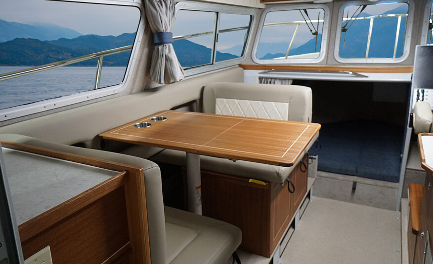 Port side dinette seating converts to bed, v-berth cuddy with memory foam mattress upgrade