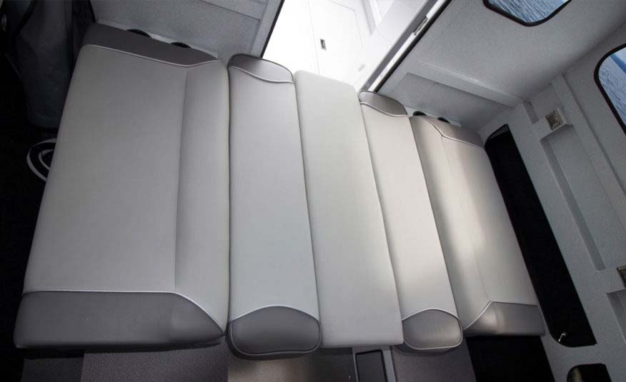 "Customize your cabin seating including the available 42"" storage bench bed conversion kit, porta pottie, or flush toilet upgrades"