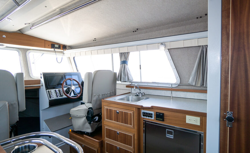 Well appointed galley include white shalestone counter tops, sapele wood cabinets with well appointed storage