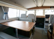 Spacious cabin with dual port side suspension seats