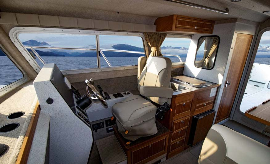 Available captain suspension seat, stand-up enclosed head, chart rack, cabin roof rod holders and grab rails