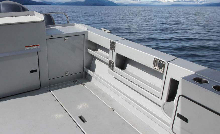 Convenient side access door, transom generator storage compartment, wide gunnels for easy downrigger mounting and commercial grade cleats